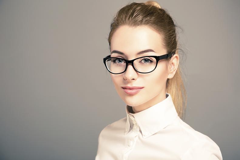 blond female wearing glasses