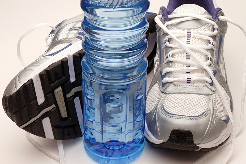 athletic shoes with water bottle