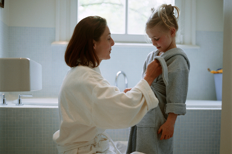 mother and daughter in bathrobes