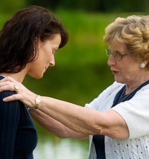 women consoling