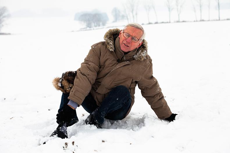 man fallen in snow