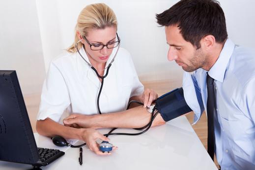 nurse checks blood pressure