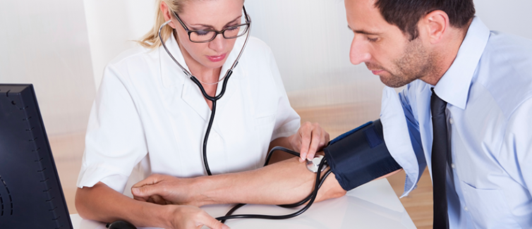 nurse checks blood pressure