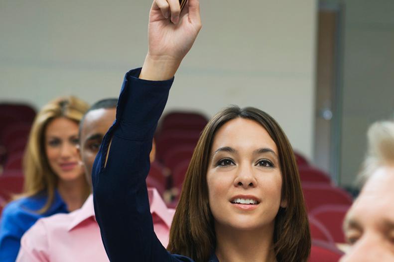 raising hand in auditorium