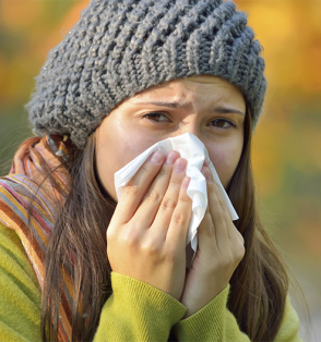 woman blowing nose in tissue