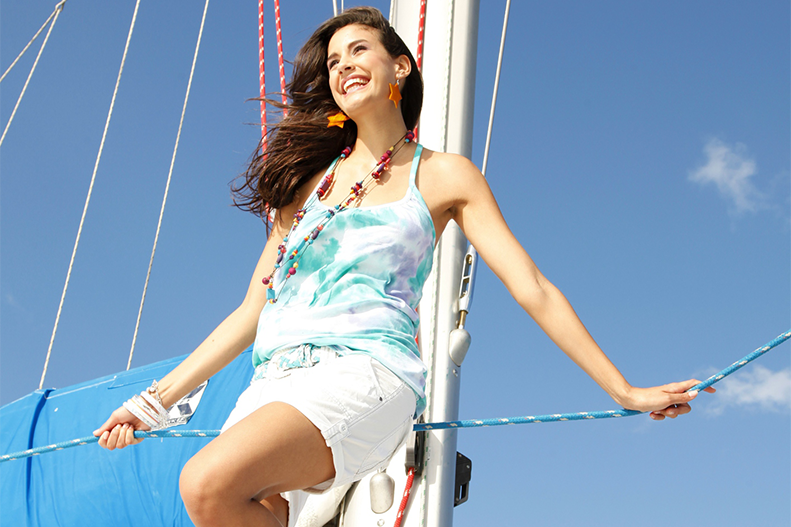 woman on sail boat in summer