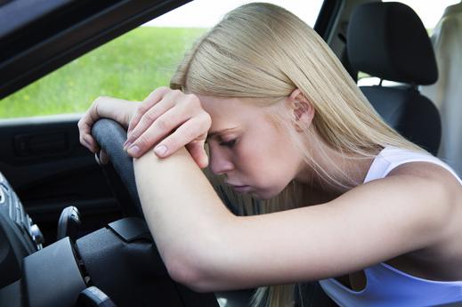 woman on steering wheel