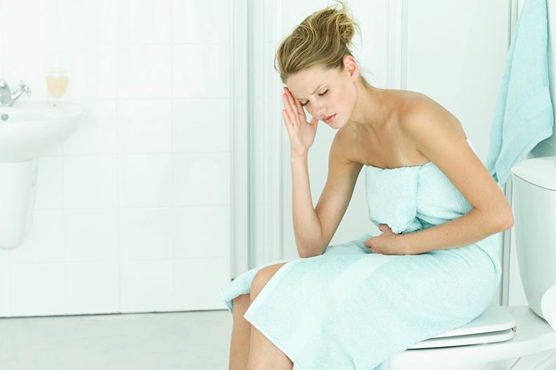 woman-sitting-in-bathroom