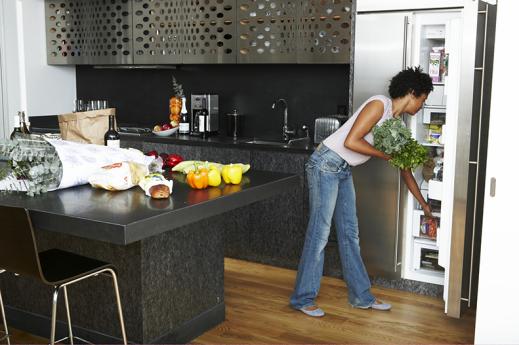 woman stocking refrigerator