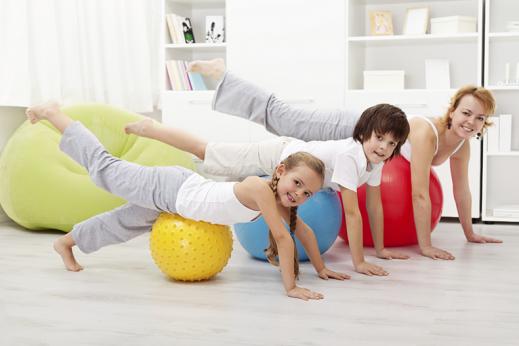 family on exercise balls