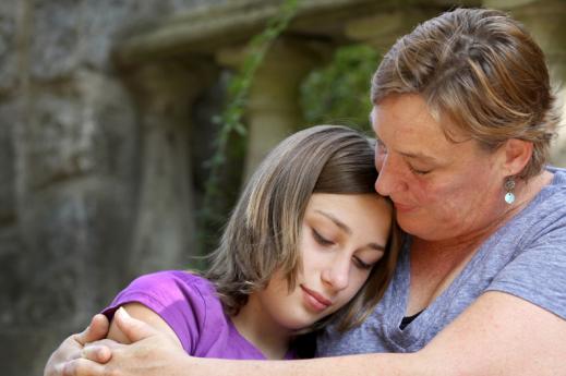 woman hugging daughter