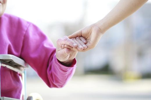 holding elderly womans hand