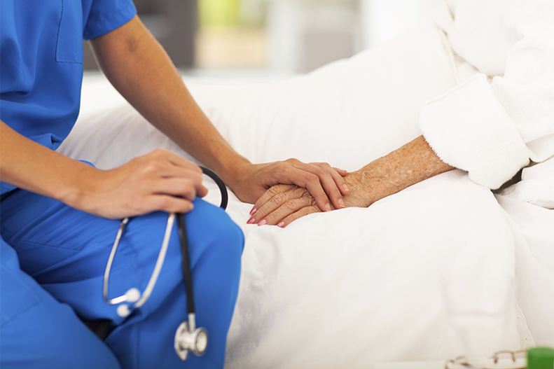 nurse holding hands with patient