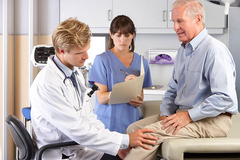 elderly man knee consultation
