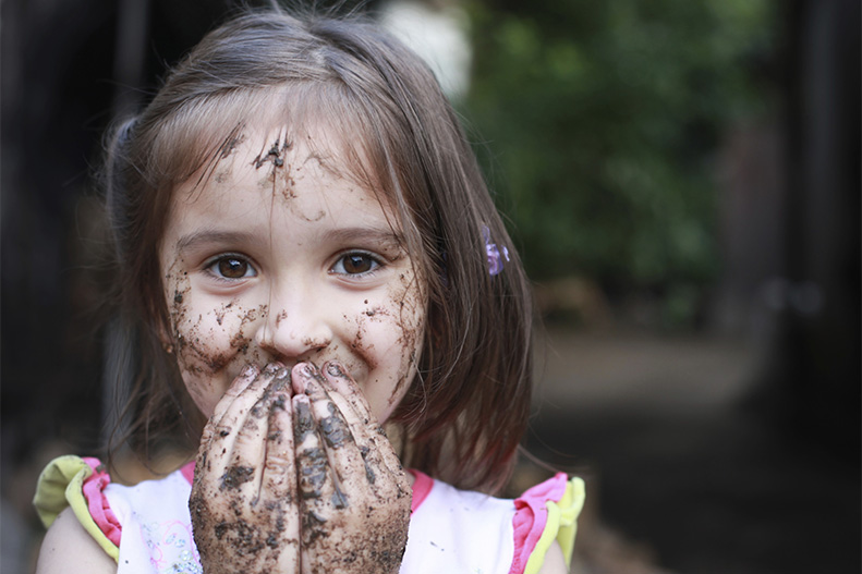 girl covered in dirt