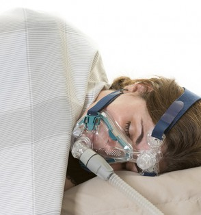 woman sleeping machine