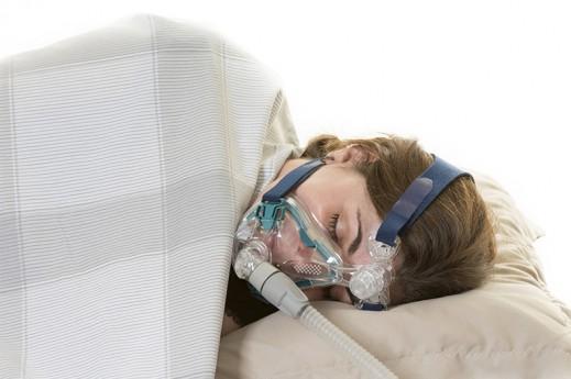 woman sleeping machine