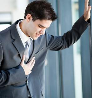 Businessman Grabbing Chest