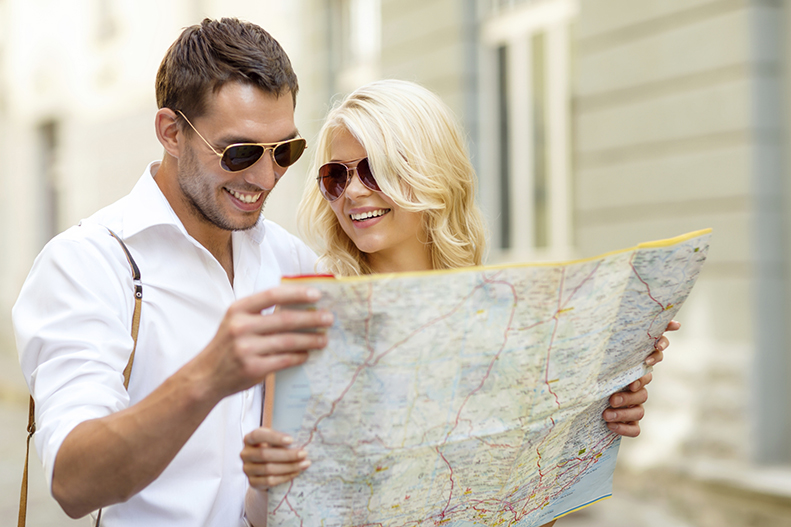 couple holding map