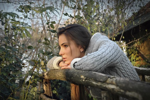sad woman in woods