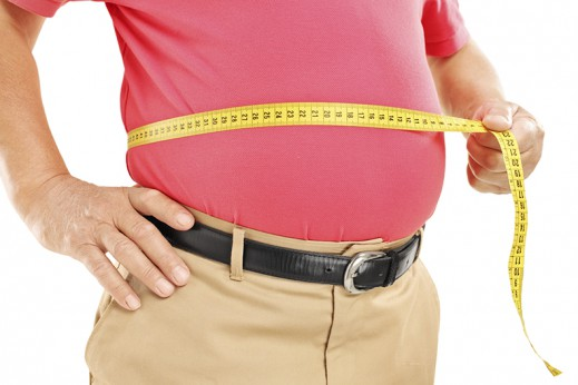man measuring belly