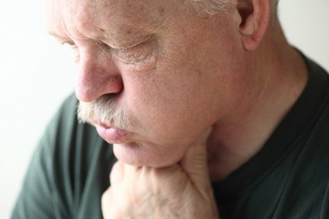 Older man suffering the effects of acid reflux