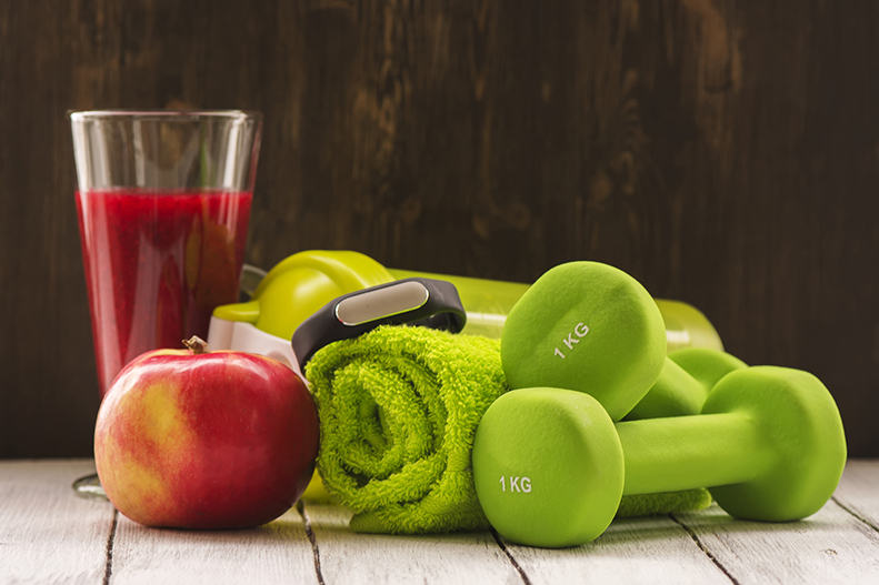 Nutrition tips for athletes including smoothie, apple, and dumbells