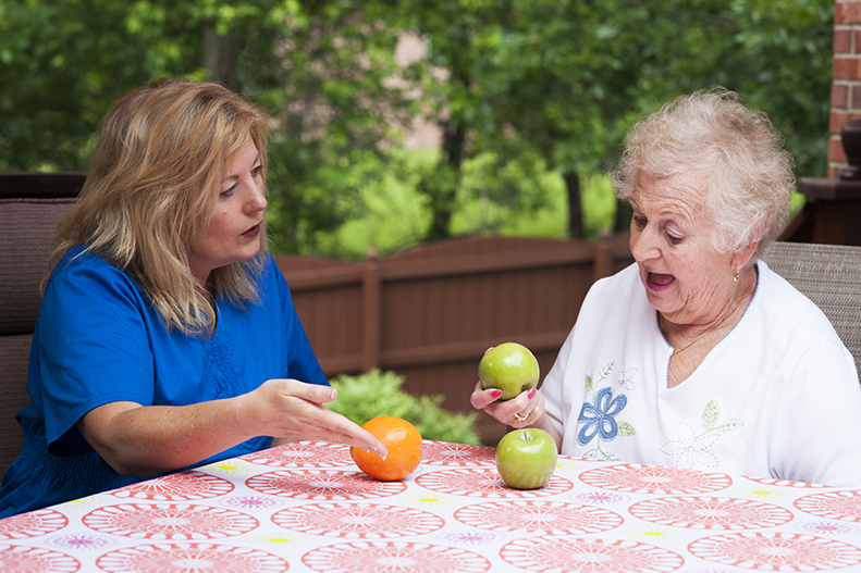 An adult woman receiving speech therapy