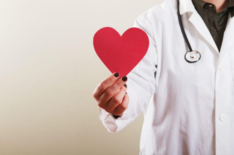Female Doctor holding Heart
