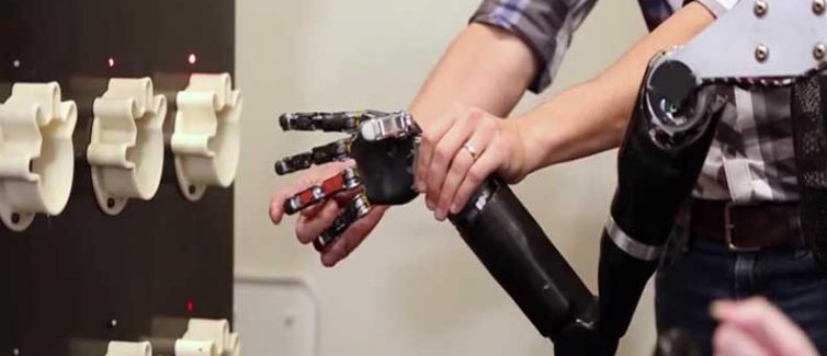 Pitt-UPMC researchers help a paralyzed man feel again with the help of a mind-controlled robotic arm
