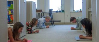Members of the UPMC marketing department do the plank challenge