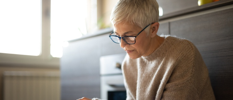 older woman on tablet
